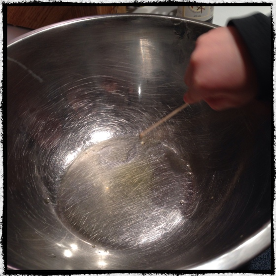 That is one teaspoon of melted beeswax. Almost invisible, but oh so fragrant. My first double boiler capsized while I was looking for a popsicle stick, so this one is over-sized. That is a long toothpick in Youngest's hand.